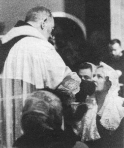 Lina Fiorellini receiving Holy Communion from Padre Pio