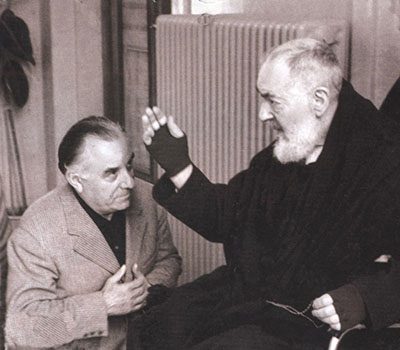 Carlo Campanini receiving a blessing from Padre Pio
