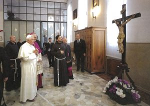 Pope Benedict XVI gazes at the wooden crucifix in the chapel of OUr Lady of Grace in San Giovanni Rotindo. Padre Pio was praying in front of this crucifix when he received the wounds of Christ, the stigmata.