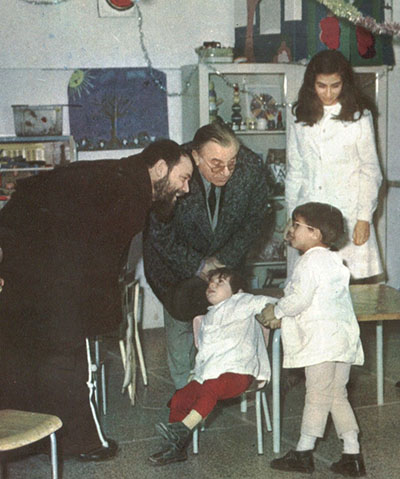 "A photo of Carlo Campanini visiting patients at Padre Pio's hospital, ""The Home for the Relief of Suffering."""