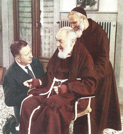 John McCaffery kneels at Padre Pio's side.