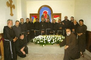 Capuchin Brothers and Priests gather at the tomb of Brother Modestino Fucci. He is buried at the Capuchins' Holy Family church in Pietreicina, Italy
